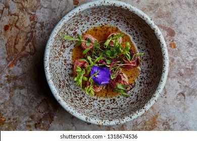 Beef tataki with miso sauce and sprouts