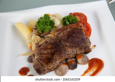Beef tenderloin grill steak on plate with mushroom and brocoli