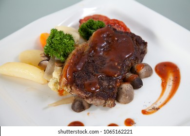 Beef tenderloin grill steak on plate with mushroom and broccoli with sauce