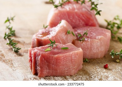 Beef with thyme on a cutting board. Selective focus