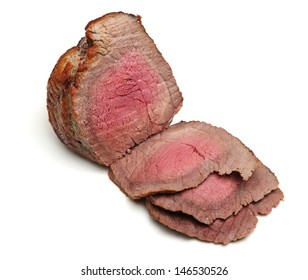 Beef topside joint roasted to medium rare.