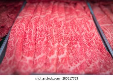beef in Tsukiji fish market japanese food in Tokyo, Japan.