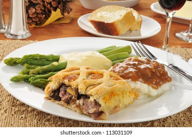 Beef wellington with asparagus and mashed potatoes