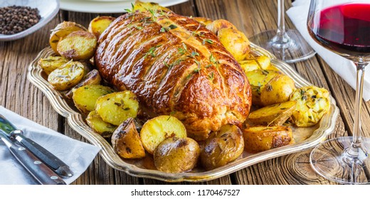 Beef Wellington, classic steak dish on rustic wooden table