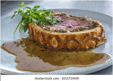 Beef Wellington in mushrooms sauce