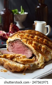 Beef Wellington on a white tray. selective focus