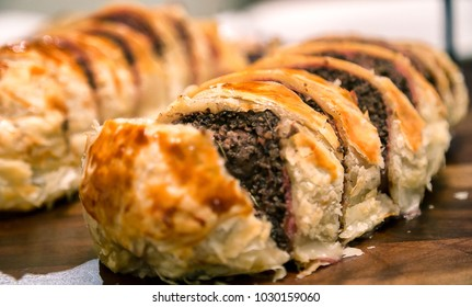 Beef Wellington is a preparation of fillet steak coated with pâté. Dinner time! Gastronomy!