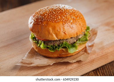 Beefburger on wood catted board