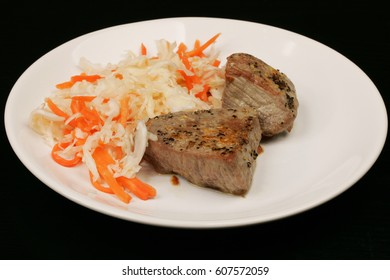 Beefsteak with Sauerkraut on white plate