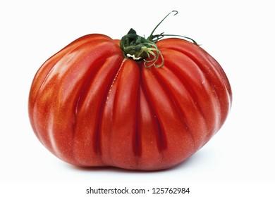 Beefsteak/heirloom tomato on white background