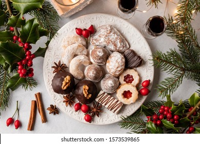 Beehives, vanilla crescents and other typical Czech Christmas cookies arranged on a white plate, top view