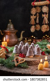Beehives or wasp nests - traditional Czech Christmas cookies, arranged on a rustic table