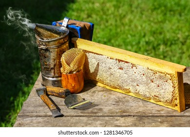 Beekeeper working tools on the hive. beekeeping equipment on a wooden table outdoors with copy space.