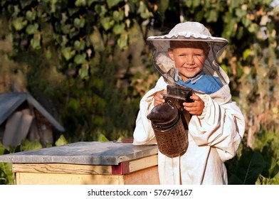 Beekeeper a young boy who works in the apiary. Beekeeping.