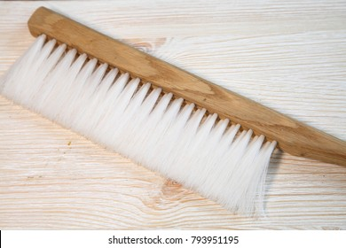 Beekeeping brush. Various beekeeping equipment. Beekeeping equipment, brush on a new beeswax.