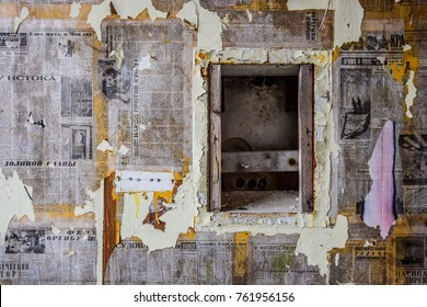 BEELITZ, GERMANY - NOVEMBER 4, 2017: Wall plastered with old Soviet newspapers at abandoned Beelitz-Heilstätten military hospital complex.
