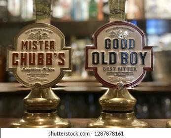 BEENHAM, BERKSHIRE - JANUARY 13, 2019: West Berkshire Brewery beer taps inside a pub in Beenham Village, Berkshire, UK.