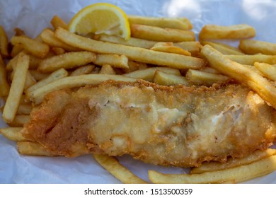 Beer battered Barramundi fish and chips  in traditional paper wrapping
