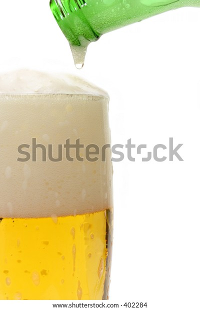 beer being poured into a glass - the last drop