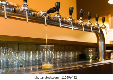 Beer being taken from the tap in brewpub, craft beer, hand of ma
