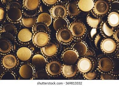 Beer bottle caps piled