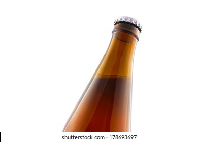 Beer bottle closeup isolated on white background