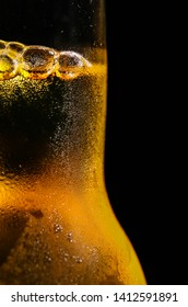 Beer bottle fill with beer and it has fussy bubbles