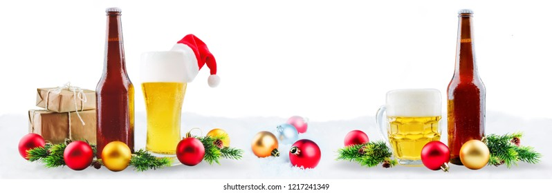 Beer in bottle and in glass with Christmas decoration isolated. Copy space. Christmas background