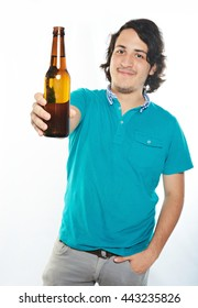 beer bottle in hand of young man isolated on white