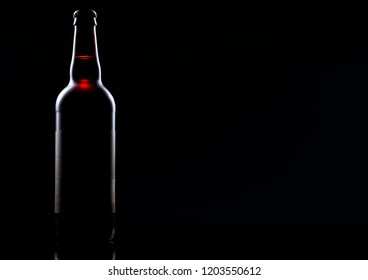 beer bottle with highlight edges on black with subtle gradient background ideal for a coming soon release announcement for the craft industry