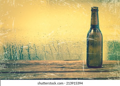 Beer bottle on wooden background