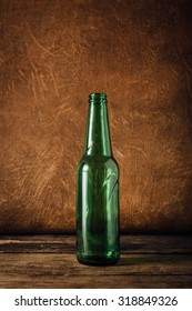 beer bottle on wooden floor with leather background