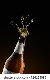 Beer bottle opening with exploding and splashing