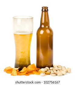 Beer bottle and potato chips, pistachios isolated on a white
