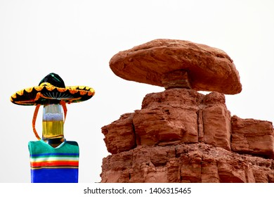 Beer bottle wearing a sombrero and hat at Mexican Hat, Utah.