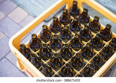 beer bottle in yellow plastic crates, glass