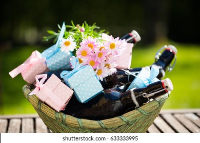 Beer bottles in a basket, with small gifts for Father's Day
