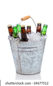 Beer bottles in a bucket of ice isolated on a white background. Vertical format with reflection.
