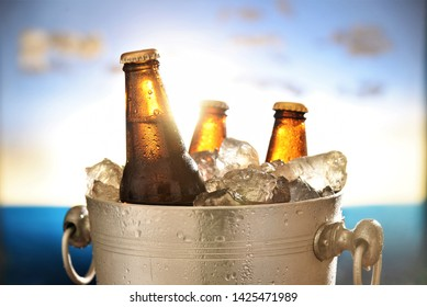 beer bottles chilled in wine cooler tank sunset sky background