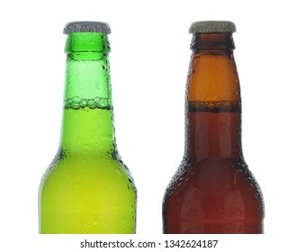 Beer Bottles: Closeup of one green and one brown beer bottle covered with condensation, on a white background.