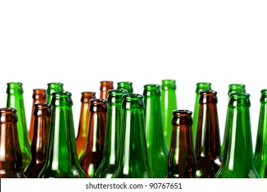 Beer bottles of green glass and a brown isolated on white background