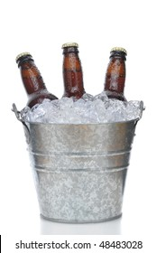Beer Bottles in Ice Bucket isolated on white vertical composition with reflection