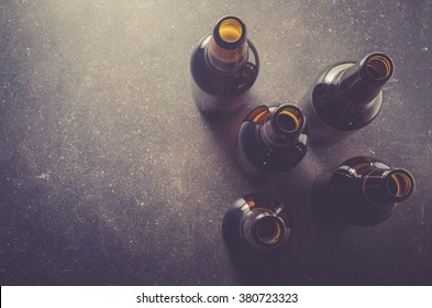 Beer bottles on dark table