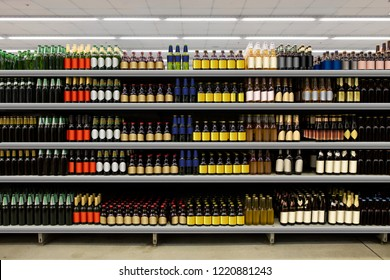 Beer bottles on shelf in supermarket with colorful blanco labels. Suitable for presenting new beer bottles and new designs of labels among many others.