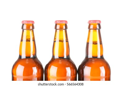 Beer bottles in a row isolated on white