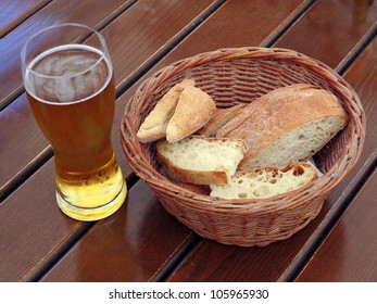 Beer and Bread on a wooden table