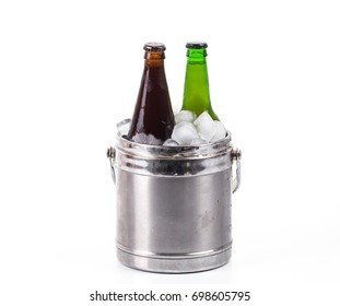 Beer in a bucket of ice on a white isolated background