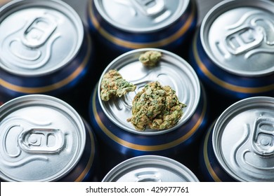 Beer cans with weed on one of them