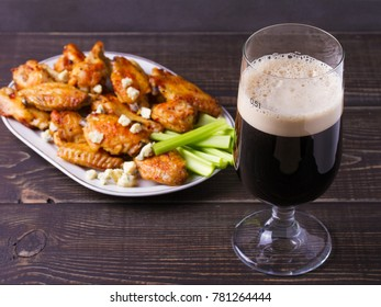 Beer and chicken wings buffalo with blue cheese and celery sticks, horizontal
