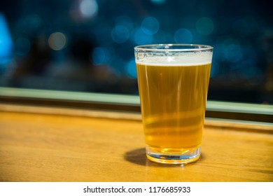 Beer in classic glass with bokeh background